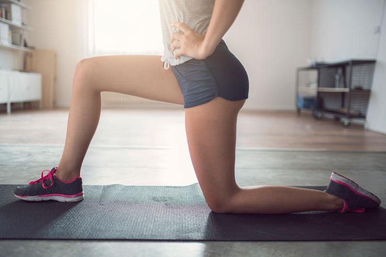 mulher a exercitar os quadríceps